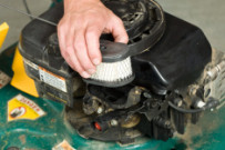 stock-photo-17858690-hand-replacing-lawnmower-air-cleaner
